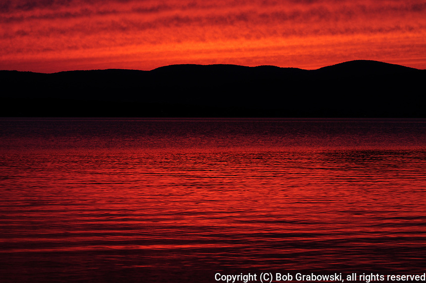 A Red Sunset Over The Great Sacandaga Reservoir In The Adirondack Mountains Of New York