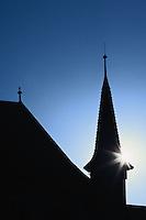 Sun behind church steeple, Zurich, Switzerland