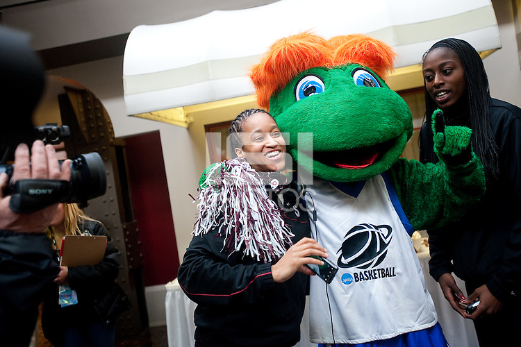 INDIANAPOLIS, IN - MARCH 31, 2011: Melanie Murphy and Chiney Ogwumike make friends with the NCAA Mascot at the NCAA Final Four in Indianapolis, IN on March 31, 2011.