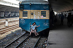 Bangladeshi children travel at the back side of a moving train at a railway station during the second day of a 48-hour general strike called by the opposition Bangladesh Nationalist Party (BNP) in Dhaka, Bangladesh.