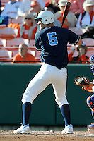 Catcher Jacob Stallings #5 of the North Carolina Tar Heels swings at a pitch during  a game against the Clemson Tigers at Doug Kingsmore Stadium on March 9, 2012 in Clemson, South Carolina. The Tar Heels defeated the Tigers 4-3. Tony Farlow/Four Seam Images.