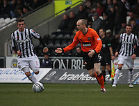 Willo Flood being closed down by Graham Carey in the St Mirren v Dundee United Clydesdale Bank Scottish Premier League match played at St Mirren Park, Paisley on 27.10.12.