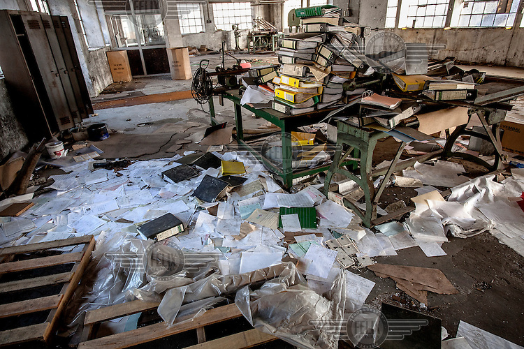 Old paperwork litters the floor in the now abandoned Robinson cork factory. The factory was founded in 1840 and stayed in production till 2009, at which time it was still partially powered by steam energy. At its peak the company employed 2000 labourers and cork is still Portugal's most important export product. /Felix Features