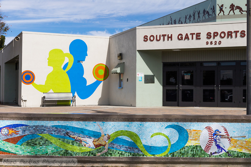 The South Gate Sports Center at South Gate Park, with the focus on the sports mural and painted monochromatic silhouettes of athletes.