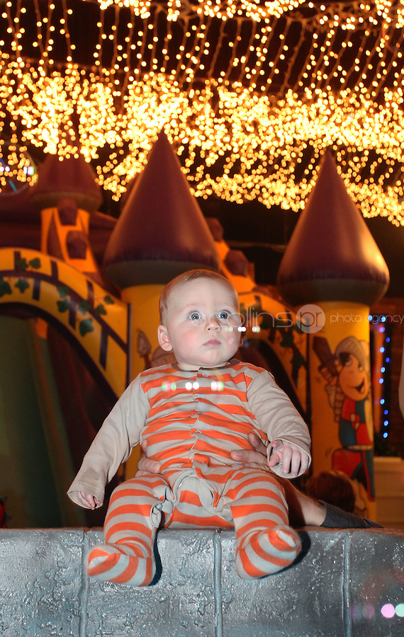 ****NO FEE PIC ******.19/11/2011.Junius Horne (5 months) from Whitehall  at The Wishing Well.during  the opening of Santa's Playland in The Ambassador Theatre,Dublin.One of this Christmas' biggest events is coming!  Santa's Playland takes up residence at The Ambassador Theatre in preparation for this year's festive season.  The spectacular event opens on Saturday 19 November and runs until Friday 23 December. Santa's Playland will see children transported to a magical Christmas paradise.On entering Santa's Playland children will be treated to a special Christmas play time.  The Play Area is full of Christmas treats with bouncy castles, slides and Christmas displays..Photo: Gareth Chaney Collins