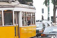Old tram. Street view. Alfama district. Lisbon, Portugal