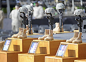 Fort Hood, TX - November 10, 2009 -- The Soldiers Cross, boots, rifle, and helmet, of the fallen are placed on the podium before the start of the memorial service for the 12 soldiers and one civilian killed at Fort Hood U.S Army Post near Killeen, Texas, USA 10 November 2009. Army Major Malik Nadal Hasan reportedly shot and killed 13 people, 12 soldiers and one civilian, and wounded 30 others in a rampage 05 November at the base's Soldier Readiness Center where deploying and returning soldiers undergo medical screenings.  .Credit: Tannen Maury / Pool via CNP
