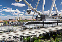 Las Vegas, Nevada.  Monorail, with High Roller in background.  The High Roller is the world's tallest observation wheel, as of 2015.  Urban growth in far back.