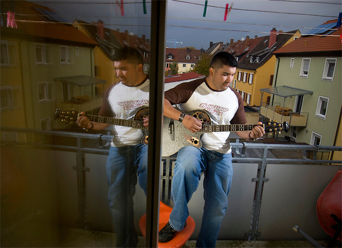 Sgt. Ely Chagoya, 31 of San Diego, CA, quit playing guitar after losing one of his men to an Improvised Explosive device in Iraq. Now, back in Germany, he's playing songs that that are tribute to the men he lost...Soldiers from Charlie Company, 1-26 Infantry took some of the greatest losses during their 15th month deployment to East Baghdad in 2006-2007. The company alone lost 14 soldiers. Returning from combat to their home in Schweinfurt, Germany, the men of Charlie Company struggle to heal from their physical and emotional wounds. (James J. Lee / Military Times)