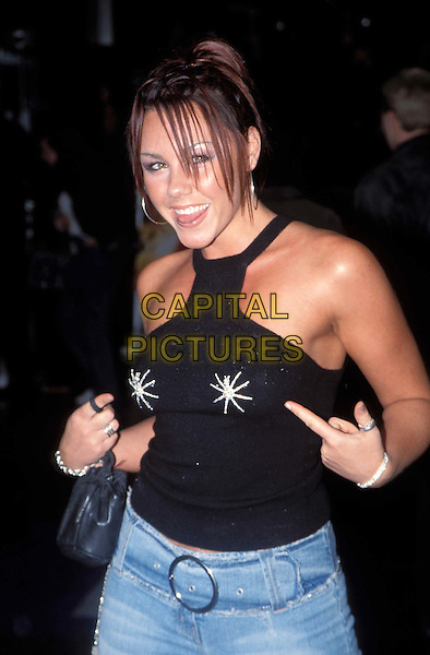 MICHELLE HEATON - LIBERTY X..Ref: 11731..pointing at nipples, halterneck top, hoop earrings..www.capitalpictures.com..sales@capitalpictures.com..©Capital Pictures..half length, half-length
