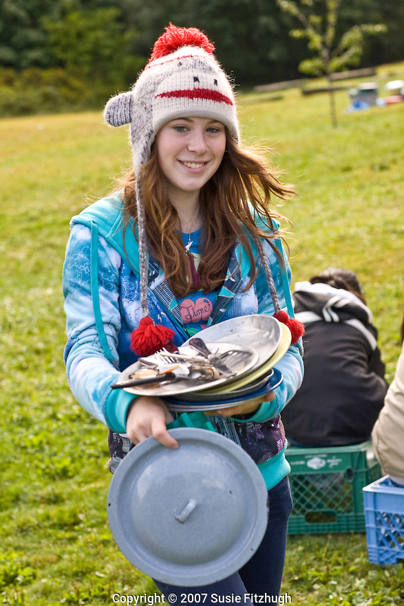 Teenagers from several different Seattle schools take part in a Youth Volunteer Corps project a Camp Sealth, on Vashon Island:  before puttng them away for the year, they are scrubbing the dishes, pots and pans used all summer at the camp.