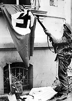 BNPS.co.uk (01202 558833)<br /> NARA/BNPS<br /> <br /> A British XXX Corps infantryman pulls down a Nazi flag. <br /> <br /> Remarkable rarely seen photos of heroic Allied soldiers fighting their way across Europe before crossing the River Rhine 75 years ago feature in a new book.<br /> <br /> They are published in Images of War, Montgomery's Rhine Crossing, which tells the story of the legendary offensive, nicknamed Operation Plunder, in March 1945.<br /> <br /> On the night of March 23, Field Marshal Bernard Montgomery's 21st Army Group launched a massive artillery, amphibious and airborne assault to breach the historic defensive water barrier protecting northern Germany.<br /> <br /> At the same time, the Americans, with the support of the British 6th Airborne Division, set in motion Operation Varsity - involving 16,000 paratroopers - on the east bank of the Rhine. They were dropped here to seize bridges to prevent German reinforcements from contesting the bridgeheads.<br /> <br /> Fierce fighting ensued, with much bloodshed on both sides as the Allies met determined resistance from machine gun nests. But the daring operation proved successful, helping to considerably shorten the war - the Nazis surrendered just six weeks later.