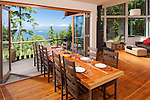 Outdoor living with folding French doors open wide and the large dining table half way out onto the porch. This image is available through an alternate architectural stock image agency, Collinstock located here: http://www.collinstock.com