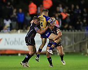 8th September 2017, The Mend-A-Hose Jungle, Castleford, England; Betfred Super League, Super 8s; Castleford Tigers versus Leeds Rhinos; Liam Sutcliffe of Leeds Rhinos is tackled by Adam Milner of Castleford Tigers  and Grant Millington of Castleford Tigers