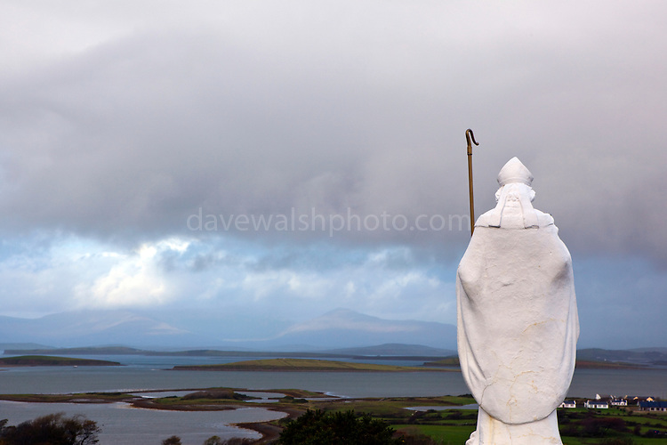 """Statue of St. Patrick overlooking Clew Bay, on the Pilgrim's Path up Croagh Patrick Mountain, Mayo, in the West of Ireland. An important site of pilgrimage, on Reek Sunday"""", the last Sunday in July every year, over 15,000 pilgrims climb it. Croagh Patrick is 764 metres (2,507 ft) high."""