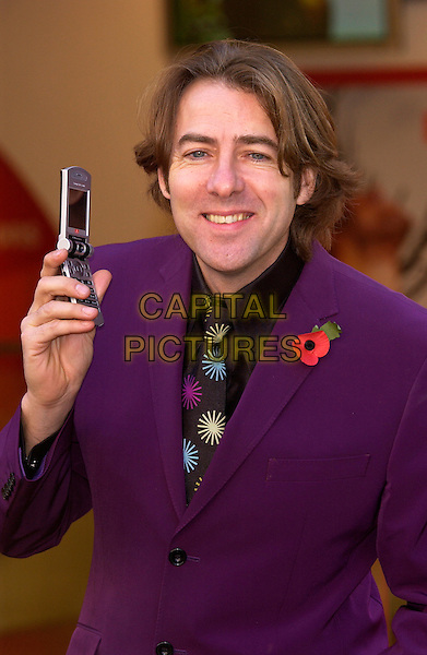 "JONATHAN ROSS.launch  of ""Vodaphone live! with 3G"".high speedcamera phone.November 10th, 2004.Ref: PL.headshot, portrait, mobile phone, purple suit, poppy.www.capitalpictures.com.sales@capitalpictures.com.©Capital Pictures."