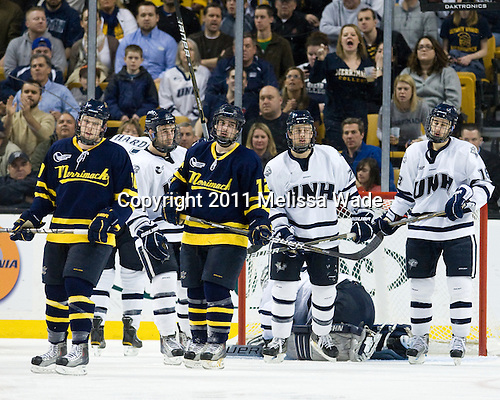 Bobby Kramer (Merrimack - 10), John Henrion (UNH - 16), Brandon Brodhag (Merrimack - 12), Mike Beck (UNH - 25), Jeff Silengo (UNH - 18) - The Merrimack College Warriors defeated the University of New Hampshire Wildcats 4-1 (EN) in their Hockey East Semi-Final on Friday, March 18, 2011, at TD Garden in Boston, Massachusetts.