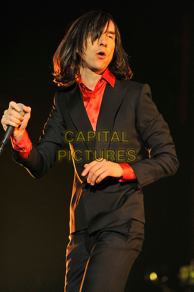PRIMAL SCREAM - BOBBY GILLESPIE.Performing live in concert to celebrate the 20th Anniversary of the band's classic album 'Screamadelica' at Olympia Exhibition Centre, London, England, UK, November 27th, 2010..on stage music gig band half length black red shirt suit microphone jacket .CAP/MAR.© Martin Harris/Capital Pictures.