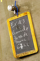 Grenache, 67 hectolitre. Chateau des Erles. In Villeneuve-les-Corbieres. Fitou. Languedoc. Concrete fermentation and storage vats. Sign on tank. France. Europe.