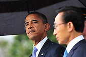 United States President Barack Obama speaks alongside South Korean President Lee Myung-bak during an arrival ceremony on the South Lawn of the White House in Washington, D.C. on Thursday, October 13, 2011.  .Credit: Kevin Dietsch / Pool via CNP