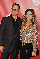 WWW.BLUESTAR-IMAGES.COM Actors Tom Hanks (L) and Rita Wilson attend 2014 MusiCares Person Of The Year Honoring Carole King at Los Angeles Convention Center on January 24, 2014 in Los Angeles, California.<br /> Photo: BlueStar Images/OIC jbm1005  +44 (0)208 445 8588