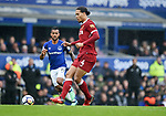 Virgil van Dijk of Liverpool is challenged by Theo Walcott of Everton during the premier league match at Goodison Park Stadium, Liverpool. Picture date 7th April 2018. Picture credit should read: Robin Parker/Sportimage