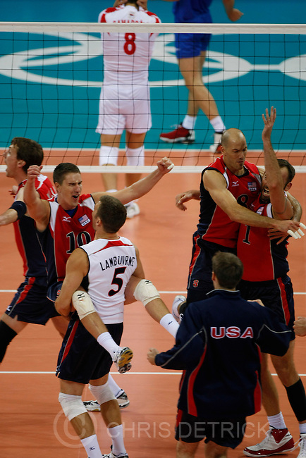 Team USA (L-R) Ryan Millar, #9, Riley Salmon, #10, Richard Lambourne, #5, William Priddy, #8,  and Lloy Ball, #1, celebrate after winning the game against Serbia in the quarterfinals match at the Capital Gymnasium in Beijing, Wednesday, August 20, 2008. USA won the match 3-2. Millar, 30-year-old Highland resident and former Brigham Young All-American and coach, is making his third Olympic appearance at the Beijing Games. Lambourne also went to BYU...Chris Detrick/The Salt Lake Tribune.