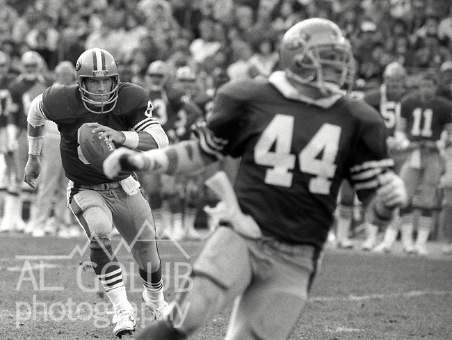 San Francisco 49ers vs Atlanta Falcons  at Candlestick Park Sunday, December 20, 1987..49ers beat Falcons 35-7.San Francisco Running Back Tom Rathman (44) blocks for Quarterback Steve Young (8)...