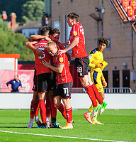 Lincoln City's Adam Jackson celebrates scoring his side's second goal with team-mates<br /> <br /> Photographer Chris Vaughan/CameraSport<br /> <br /> The EFL Sky Bet League One - Saturday 12th September 2020 - Lincoln City v Oxford United - LNER Stadium - Lincoln<br /> <br /> World Copyright © 2020 CameraSport. All rights reserved. 43 Linden Ave. Countesthorpe. Leicester. England. LE8 5PG - Tel: +44 (0) 116 277 4147 - admin@camerasport.com - www.camerasport.com - Lincoln City v Oxford United