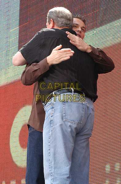 LEONARDO DiCAPRIO & AL GORE.At the Live Earth New York Show held at Giants Stadium, East Rutherford, New Jersey, USA,.07 July 2007..concert on stage gig music hugging embracing back behind Di Caprio  Leo.CAP/ADM/MK.©Mike Klein/AdMedia/Capital Pictures.