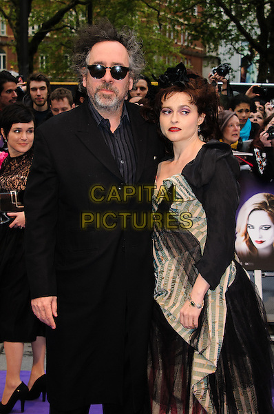 Tim Burton and Helena Bonham Carter.'Dark Shadows' european premiere, Leicester Square, London, England..9th May 2012.half length black dress couple sunglasses shades tulle pink white striped stripes blue jacket .CAP/CJ.©Chris Joseph/Capital Pictures.