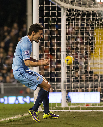 21.12.2013 London, England.  Manchester City's Jesus NAVAS scores to make it 3-2 during the Premier League game between Fulham and Manchester City from Craven Cottage.