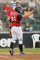 Catcher Kevin Dubler #35 of the Kannapolis Intimidators lets his defense know there are 2 outs against the Delmarva Shorebirds at Fieldcrest Cannon Stadium May 14, 2010, in Kannapolis, North Carolina.  Photo by Brian Westerholt / Four Seam Images
