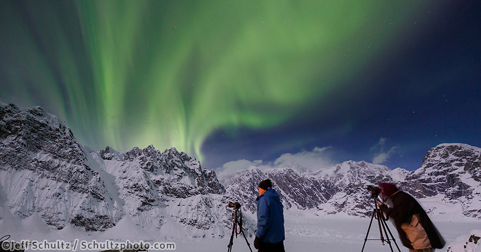 Photographers take photos of the Aurora Borealis (aka Northern Lights) on the deck of the Sheldon Chalet in the Ruth Glacier and Amphitheater in the Alaska Range.  Denali (aka: Mt. Mckinley) in the background. Winter <br /> <br /> Photo by Jeff Schultz/SchultzPhoto.com  (C) 2017  ALL RIGHTS RESERVED