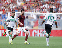 Calcio, Serie A: Roma vs Sassuolo. Roma, stadio Olimpico, 20 settembre 2015.<br /> Roma&rsquo;s Miralem Pjanic, center, is challenged by Sassuolo&rsquo;s Francesco Magnanelli, left, and Gregoire Defrel during the Italian Serie A football match between Roma and Sassuolo at Rome's Olympic stadium, 20 September 2015.<br /> UPDATE IMAGES PRESS/Isabella Bonotto