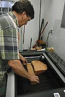 using shims, Zack Ellison makes the trophy level for laser engraving