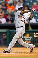 Detroit Tigers outfielder Torii Hunter (48) follows through on his swing during the MLB baseball game against the Houston Astros on May 3, 2013 at Minute Maid Park in Houston, Texas. Detroit defeated Houston 4-3. (Andrew Woolley/Four Seam Images).