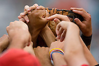 The St. John's Red Storm show their unity before taking on the Virginia Cavaliers at the Charlottesville Regional of the 2010 College World Series at Davenport Field on June 6, 2010, in Charlottesville, Virginia.  The Red Storm defeated the Cavaliers 6-5.   Photo by Brian Westerholt / Four Seam Images