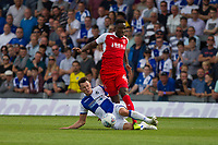 Ollie Clarke of Bristol Rovers challenges Devante Cole of Fleetwood Town during the Sky Bet League 1 match between Bristol Rovers and Fleetwood Town at the Memorial Stadium, Bristol, England on 26 August 2017. Photo by Mark  Hawkins.