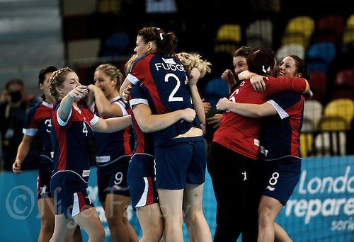 23 NOV 2011 - LONDON, GBR - British players celebrate the teams 22 -20 victory over Angola in the 2011 London Handball Cup match at The Handball Arena in the Olympic Park in Stratford, London .(PHOTO (C) NIGEL FARROW)