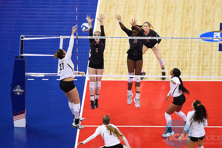 COLUMBUS, OH - DECEMBER 17:  Jenna Gray (1) and Inky Ajanaku (12) of Stanford University jump for a block against the University of Texas during the Division I Women's Volleyball Championship held at Nationwide Arena on December 17, 2016 in Columbus, Ohio.  Stanford defeated Texas 3-1 to win the national title. (Photo by Jamie Schwaberow/NCAA Photos via Getty Images)