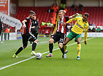 Mark Duffy and Kieron Freeman of Sheffield Utd in action with Josh Murphy of Norwich City during the Championship match at Bramall Lane Stadium, Sheffield. Picture date 16th September 2017. Picture credit should read: Jamie Tyerman/Sportimage