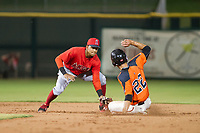 AZL Angels second baseman Gleyvin Pineda (72) applies a tag to Nick Hill (22) during a game against the AZL Giants on July 10, 2017 at Scottsdale Stadium in Scottsdale, Arizona. AZL Giants defeated the AZL Angels 3-2. (Zachary Lucy/Four Seam Images)