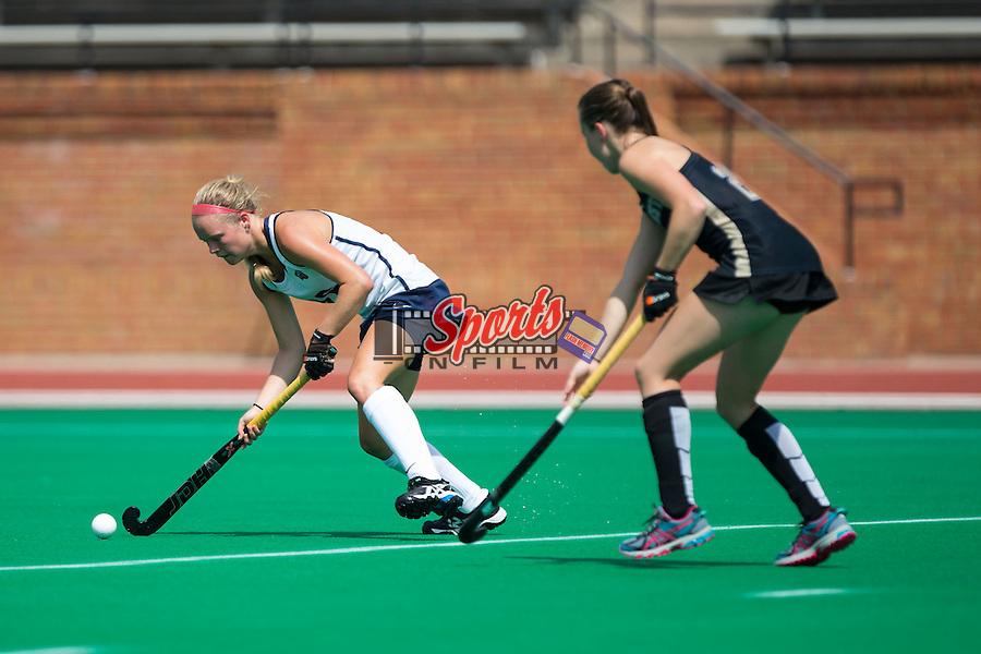 Cassidy Bremner (16) of the Liberty Flames passes the ball during second half action against the Wake Forest Demon Deacons at Kentner Stadium on September 20, 2015 in Winston-Salem, North Carolina.  The Demon Deacons defeated the Flames 2-1.  (Brian Westerholt/Sports On Film)