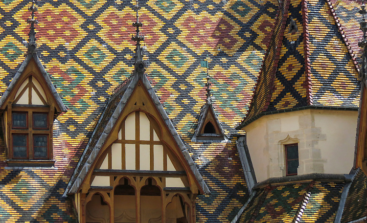 VMI Vincentian Heritage Tour: Members of the VMI tour the Hospices de Beaune or Hôtel-Dieu de Beaune, with their roofs featuring glazed-tile, Wednesday, June 29, 2016. The hospital is a former charitable almshouse in Beaune, France. It was founded in 1443 by Nicolas Rolin, chancellor of Burgundy, as a hospital for the poor. (DePaul University/Jamie Moncrief)