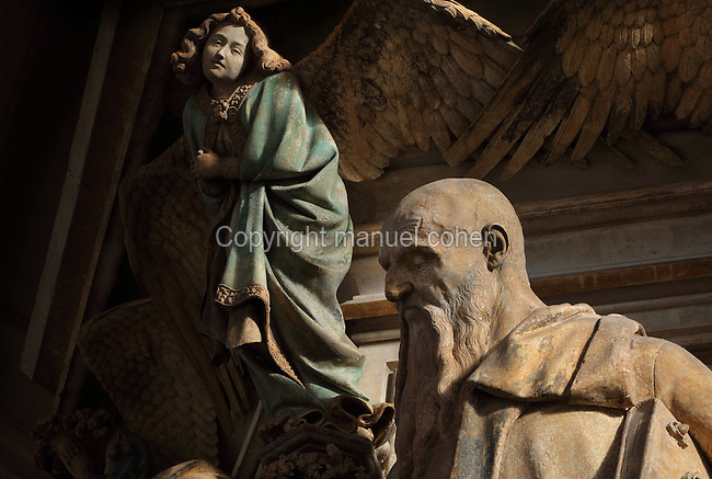 Isaiah with angel behind, from the Puits de Moise, or Well of Moses, 1395-1403, sculpted by Claus Sluter, 1340-1406, and his studio, and painted by Jean Malouel, 1365-1415, in the courtyard of the Chartreuse de Champmol, the burial site of Philippe le Hardi duc de Bourgogne, or Philip the Bold Duke of Burgundy, now the Hospital de la Chartreuse, Dijon, Burgundy, France. The sculpture was commissioned by Jean sans Peur or John the Fearless, and consists of a crucifixion scene surrounded by 6 prophets (Moses, David, Jeremiah, Zachariah, Daniel and Isaiah), with 6 weeping angels. The hexagonal building surrounding the sculpture was added in the 17th century. Picture by Manuel Cohen