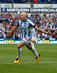 Aaron Mooy of Huddersfield Town celebrates scoring the first goal during the premier league match at the John Smith's Stadium, Huddersfield. Picture date 20th August 2017. Picture credit should read: Simon Bellis/Sportimage