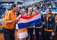 Bratislava, Slovenia, April 23, 2017,  FedCup: Slovakia-Netherlands,seccond rubber sunday,  The Dutch team celebrate their win over Slovakia 3-1, lor Camtain Paul Haarhuis, Richel Hogenkamp, Kiki Bertens, Arantxa Rus and Cindy Burger<br /> Photo: Tennisimages/Henk Koster