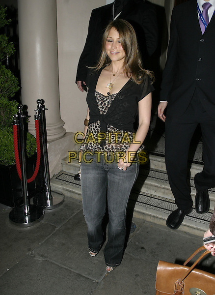 RACHEL STEVENS.Attends the Adler 20th Anniversary Party, No 5 Cavendish Aquare, London, May 4th 2005..full length gold clutch bag purse leopard print top black shrug .Ref: AH.www.capitalpictures.com.sales@capitalpictures.com.©Adam Houghton/Capital Pictures.