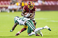 Landover, MD - August 16, 2018: Washington Redskins wide receiver Brian Quick (83) avoids the tackle of New York Jets defensive back Terrence Brooks (23) during preseason game between the New York Jets and Washington Redskins at FedEx Field in Landover, MD. (Photo by Phillip Peters/Media Images International)
